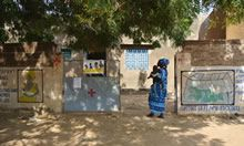 Photo of a woman walking by a clinic - credit: Sally Abbott, PhD