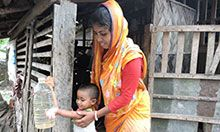 Aporna Shikder and her daughter use a tippy tap to wash their hands in rural Bangladesh.