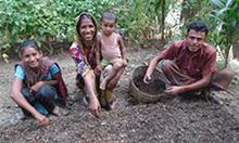 Nasima's family helps her prepare and use the compost that allows them to grow more nutritious vegetables. Photo credit: SPRING/Bangladesh