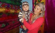 Seitova Raima holding her child