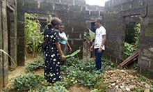 SPRING Nutrition Coordinator Grace Essien visits a household vegetable garden in Ebom, Nigeria, where residents believed they could not grow their own food.