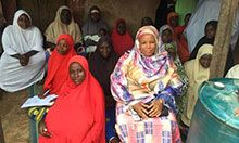 Hajiya Abdullahi talks with infant and young child feeding support group members in Toto, Nigeria.