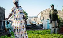 Thiane Dramé waters the garden SPRING helped her to diversify.
