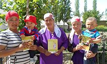 Photo of a group of women holding up SPRING nutrition counseling materials.