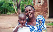 Whitney, 2, with his grandmother Zewelensi, 60. Whitney was malnourished, but after three months of eating foods mixed with MNP, his health improved.