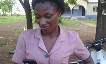 Faustina Kiisi, a community health nurse at Tolon Health Center, reaches out to her colleagues on WhatsApp.