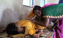 Health worker examining pregnant woman