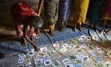 Grandmothers participating in a focus group sort cards of local foods into piles that indicate each food's affordability locally.