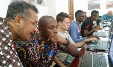 Victor provides guidance to Oury Barry, IT Manager for Peace Corps Guinea, on Photoshop skills.