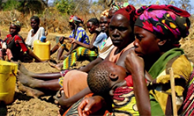 women holding children