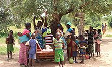 Cover photo: a group of several mothers and their children gathered outside by a tree. Photo by Souleymane Ouattara, Jade Video Production.