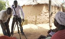Videographers film a woman and her child