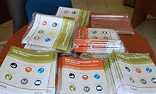 A table with stacks of copies of the DATA tool materials.