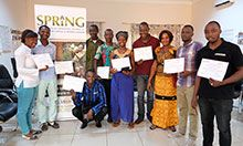 All of the workshop participants display their completion certificates.