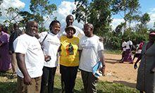 SPRING staff enjoy a moment with the Honerable Karoro Okurut, the Minister of Gender.