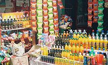 Photo of brightly colored junk food at a market. Credit: Lokendra Nath Roychoudhury