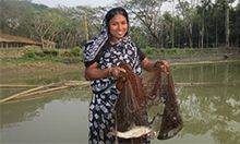 Women holds a net with a fish