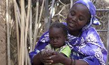 Hassaya and her child wash their hands