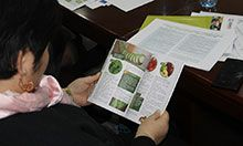 A participant looks at a copy of the new publication for home based storage and preservation of nutritious foods in the Kyrgyz Republic.