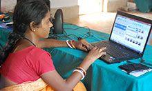 A woman edits videos on a laptop