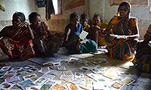 Photograph of a group of women in India using instructional cards