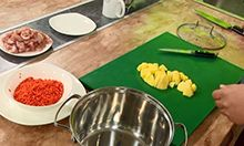 Clip from the video featuring food preparation.