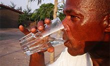 Photo of a man drinking water. Copyright 2001 Erberto Zani, Courtesy of Photoshare