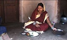 pregnant woman displaying an appropriate meal for pregnant women