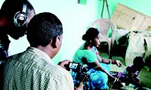 Cover image featuring a film crew making a community video.