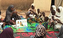 Women attend a C-IYCF support group meeting in Nigeria. Sascha Lamstein, SPRING.