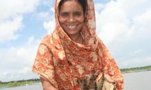 Photo of a woman smiling in front of a lake