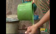 Screen capture of woman washing hands
