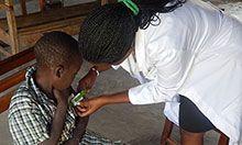 Nurse taking MUAC measurements
