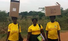 Village health team members with boxes on MNPs and related materials