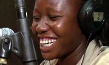 Woman in a radio station. Courtest of Development Media International