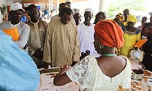 Photo: SPRING/Senegal nutrition advisor, Mariam Sy, speaks to guests about SPRING's accomplishments in nutrition, gender and hygiene at one of the stands set up to showcase project achievements.