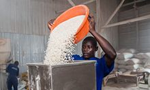 Photo of a man pouring flour into a machine