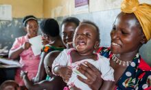 Cover photo: a young mother holding her smiling child in a clinic