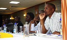 Participants listen to SPRING's findings on the current status of maize milling.
