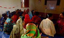 women watching instructional video