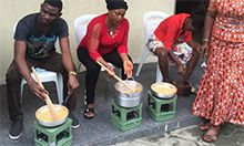 Photo of three people cooking in pots