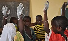 Photo of kids with raised hands