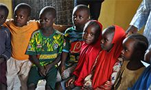 Photo of several boys seated together