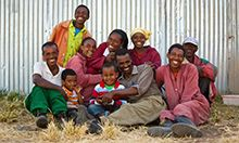 Cover image of the Session Guide: a group photo of a family smiling.